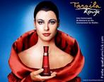 """Apropriação da obra """"Manto Vermelho"""" de Tarsila do Amaral. O publicitário utilizou a imagem da própria artista, considerada uma mulher à frente de sua época, para relacionar elegância, ousadia e modernidade com estilo de vida da mulher que usa """"O Boticário"""" (lançado em 2006 em homenagem ao Dia Internacional da Mulher). Tarsila do Amaral (1886-1973) foi uma das mais importantes artistas do Brasil. Após passar dois anos em Paris, retorna a São Paulo em 1922 para integrar o """"Grupo dos Cinco"""", que defende as ideias da Semana de Arte Moderna e toma a frente do Movimento Modernista do país. Veja também o vídeo Arte na Publicidade I, II, III."""