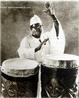 Babatunde Olatunji nasceu a 7 de Abril de 1927 em Ajido, Lagos, na Nigéria, e morreu a 6 de Abril de 2003, nos Estados Unidos. Gravou em 1957 o álbum «Drums of Passion». Babatunde fundou o Olatunji Center for African Culture, em Harlem, Nova Iorque, e foi o guru de inúmeros bateristas, percussionistas e outros músicos (de Bob Dylan a Santana, de Mickey Hart a Airto Moreira, de Quincy Jones a Stevie Wonder, de Max Roach a Muruga Booker), Olatunji foi também um activista dos direitos civis nos EUA, ao lado de Martin Luther King e, depois, de Malcolm X.